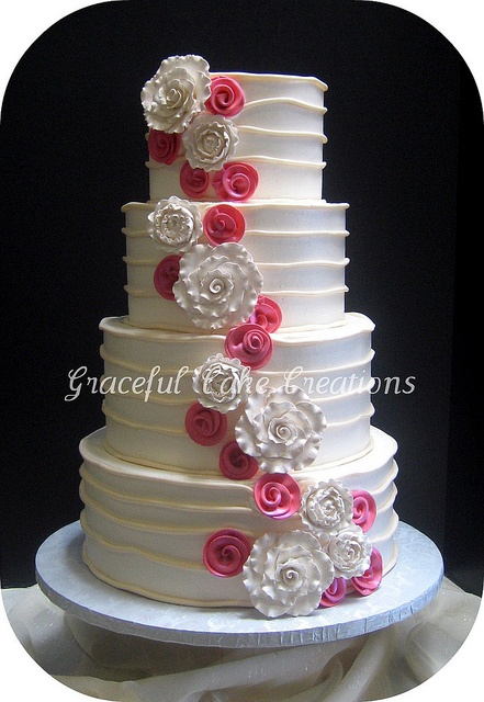 Ivory and Coral Pink Wedding Cake. I would prob use multiple pastel color for the pink ones