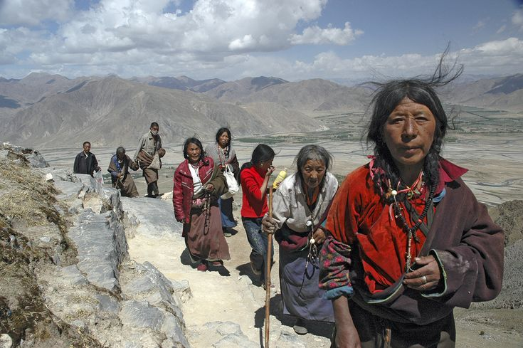 https://flic.kr/p/eEtoK | Tibetan pilgrims at Ganden kora | Pilgrims walking the kora at Ganden monastery. Kora is a religious exercise, in which a holy object is circumambulated - in this case the monastery itself and the adjecent hilltop. Ganden, appr. 50 km from Lhasa, lies at an altitude of 4800 m. During the cultural revolution it was virtually destroyed by Chinese artillery. Now it is being rebuilt.