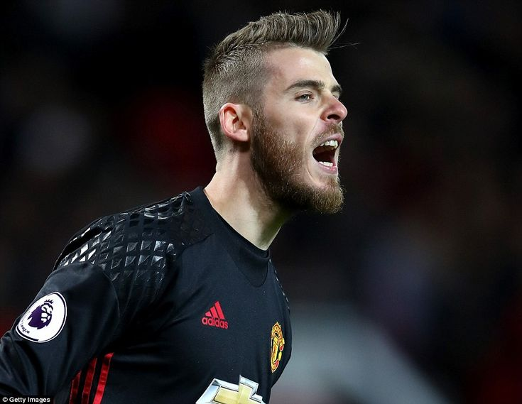 Manchester United goalkeeper David De Gea barks out orders to his defenders during the ear...