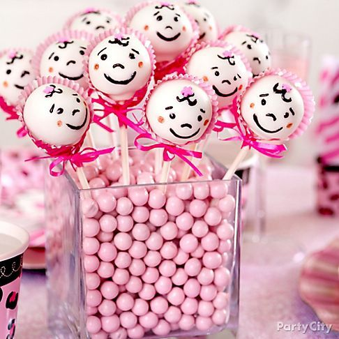 "Candy + cake pops = sweet centerpiece for the new mom!  These girl baby shower cake pops with mini baking cup ""bonnets"" are almost too cute to eat! :)"