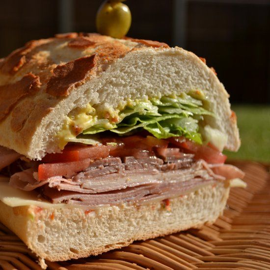 A Dagwood sandwich. Made popular by the cartoon Blondie, it is a sandwich which aspires vertically.