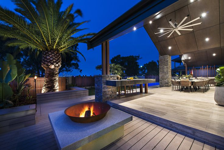 Adding a fire pit will get the conversation started!  Home designed and built by Urbane Projects, Perth