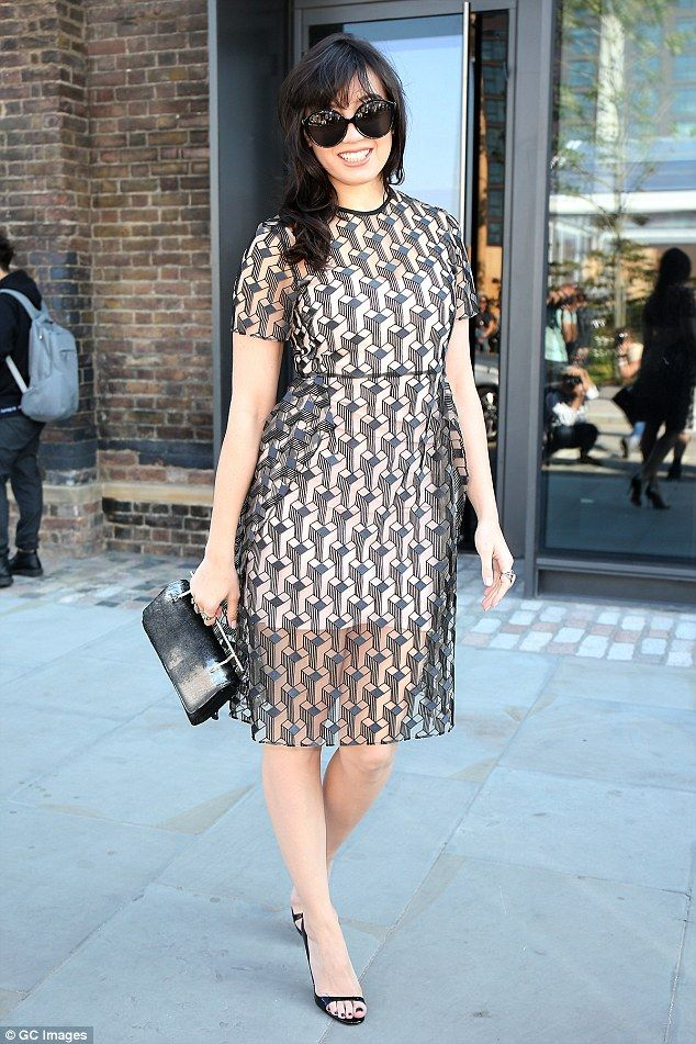 Daisy, 26, looked sensational in a sheer, graphic print dress as she arrived at the show...
