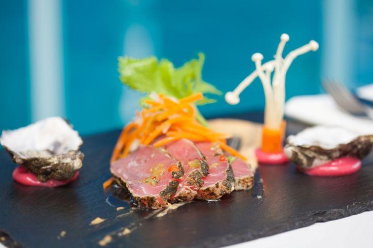 Yellowfin tuna tataki w enoki mushrooms, freshly shucked coffin bay oysters and miso emulsion