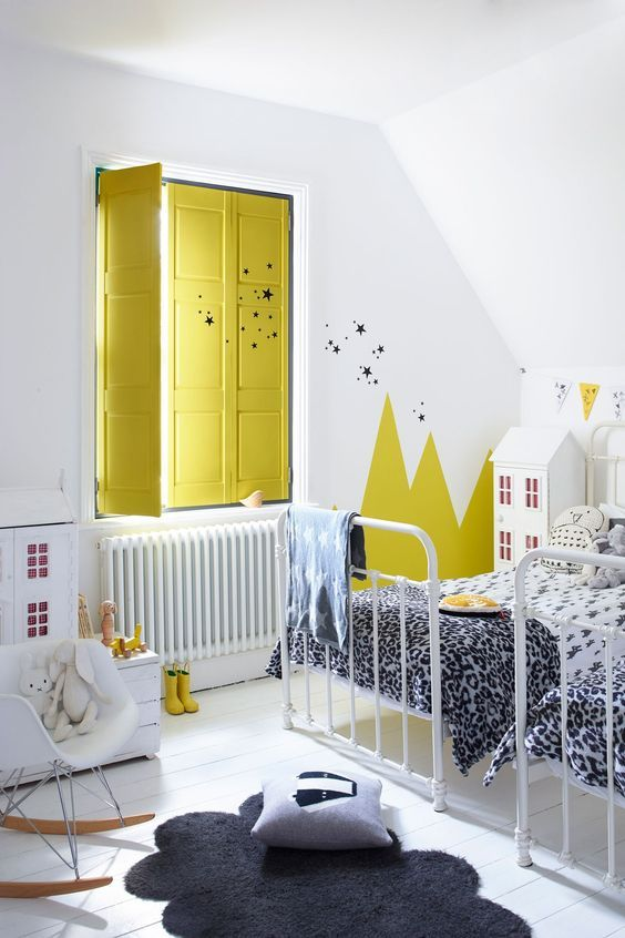 Bright, glossy yellow isn't for everyone. So if you prefer something a little softer, why not try painting the top half of the wall in yellow? This white and grey kids room is brought to life with that half painted lemon yellow wall. http://petitandsmall.com/5-yellow-paint-accents-kids-room/