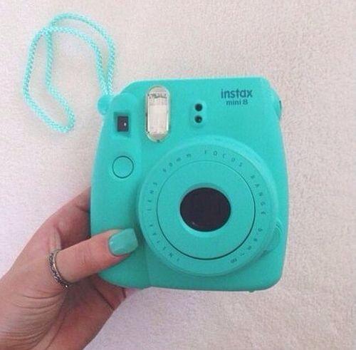 Teal camera polaroid