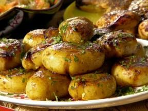 Yukon Gold Potatoes, Jacques Pepin Style -  cooked in chicken broth, then gently crushed and browned.