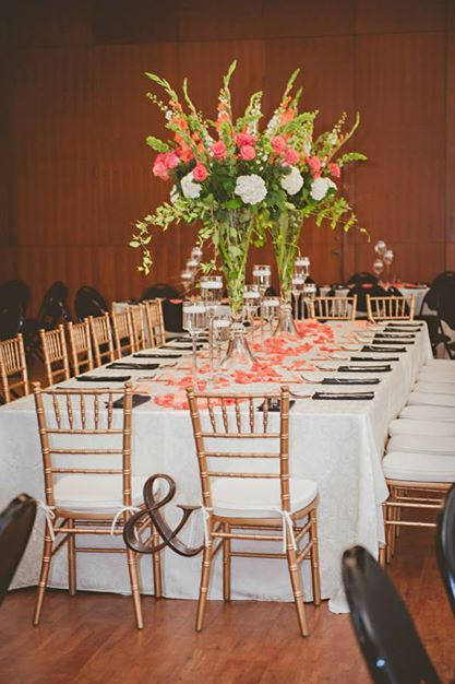 beautiful head table from my May wedding. Coral centerpieces, roses, hydrangeas, gladiolus, bells of ireland + ampersand