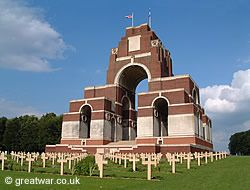 Thiepval Memorial to the Missing, with French graves of the Anglo-French Cemetery in the foreground.