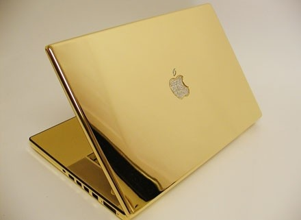 I need this to go with my shiny new ring... | The 24-carat gold MacBook Pro