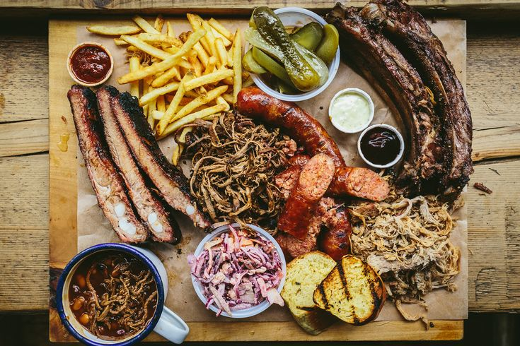The Board. Mixed BBQ including, Andouille Sausaage, Brisket, Hog Butt, Beef Rib, Pork Ribs, Pit Beans and Fries.