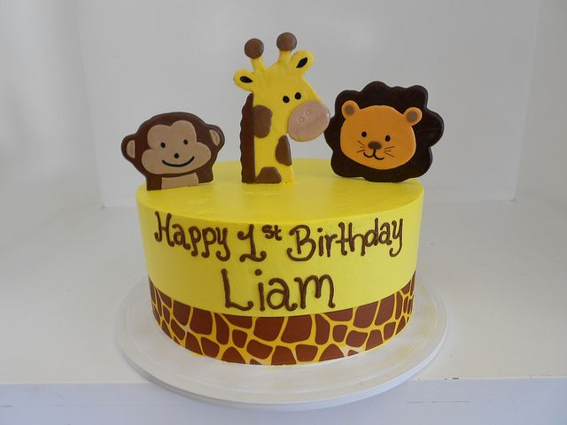 Animal first birthday cake