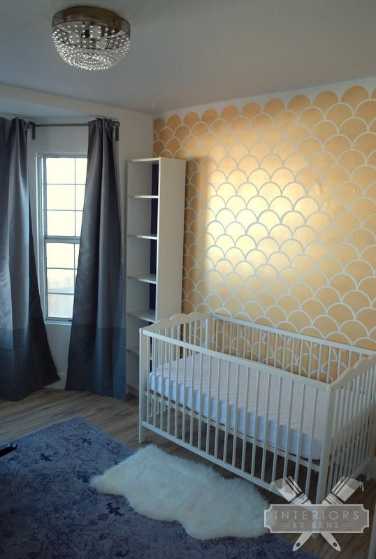 Love this nursery!  The stenciled wall and bookcases are adorable!