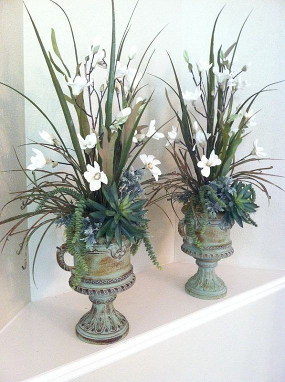 These would be beautiful for a wedding.  Pair of Tall Faux Floral Arrangements - White Magnolia & Succulent Silk Floral Arrangements - Elegant Urn Floral Arrangements by Greatwood Floral Designs.