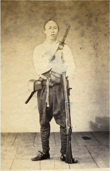 Samurai with musket and sword, 1860's.