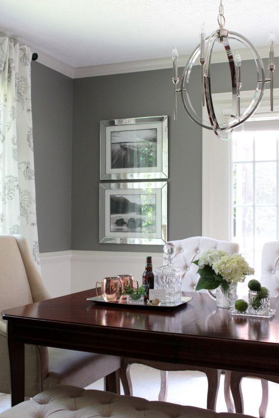 Modern Meets Classic Gray Dining Room.  Antique furniture - A Modern Chandelier - Linen Chairs - Before & After Photos!
