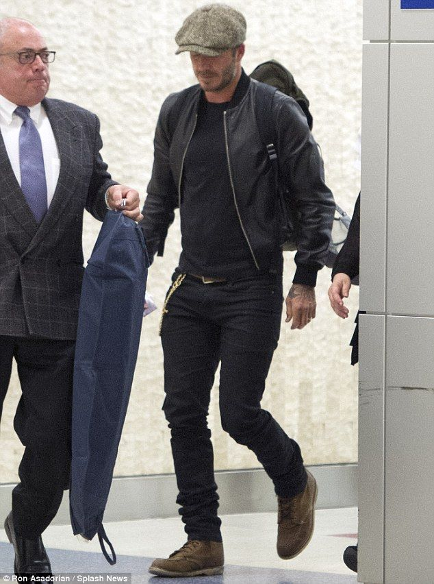 Touching down: David Beckham looked as stylish as ever in an all-black ensemble as he arrived at JFK Airport in New York City on Sunday