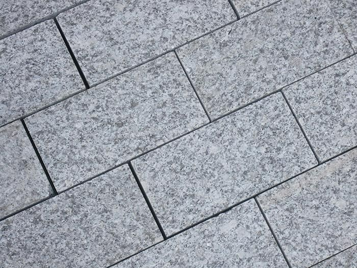 Silver Grey Sawn Granite Setts are a stylish solution for paths and for creating a contrasting edging or border, especially when paired with a darker stone such as Black Basalt or Midnight Black Limestone.