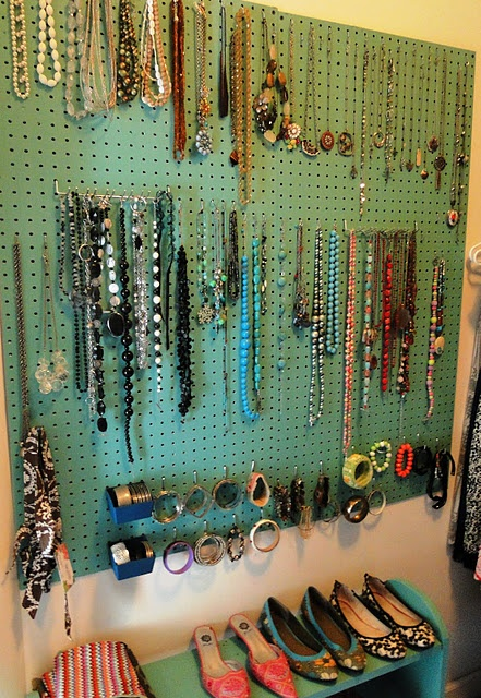 Peg board from Lowe's painted a fav color with hooks to hang necklaces and braclets. Great idea!!!