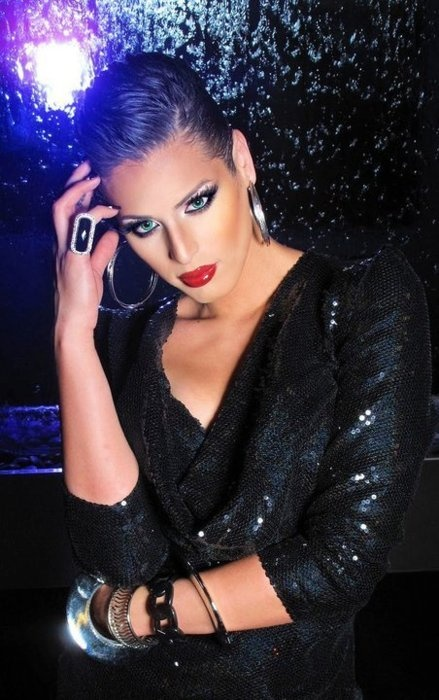 Christopher Roman, better known by his stage name Carmen Carrera, was born in Elmwood Park, New Jersey and he is an American reality television personality and drag queen,