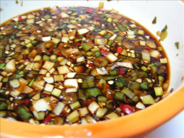 Finadene Sauce from Food.com:   								This is a doctored-up soy sauce recipe that came from Guam. Over there, this is always by the red rice and barbequed ribs and chicken. It really adds a nice flavor to the rice! Try it next time you serve plain or fried rice! YUM!