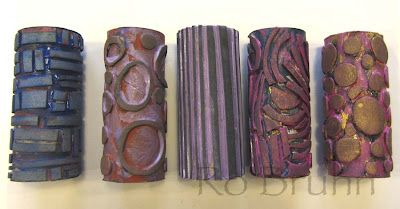 Make roller stamps out of thin foam glued  to toilet rolls inners.....slip them over a foam paint roller and voila!