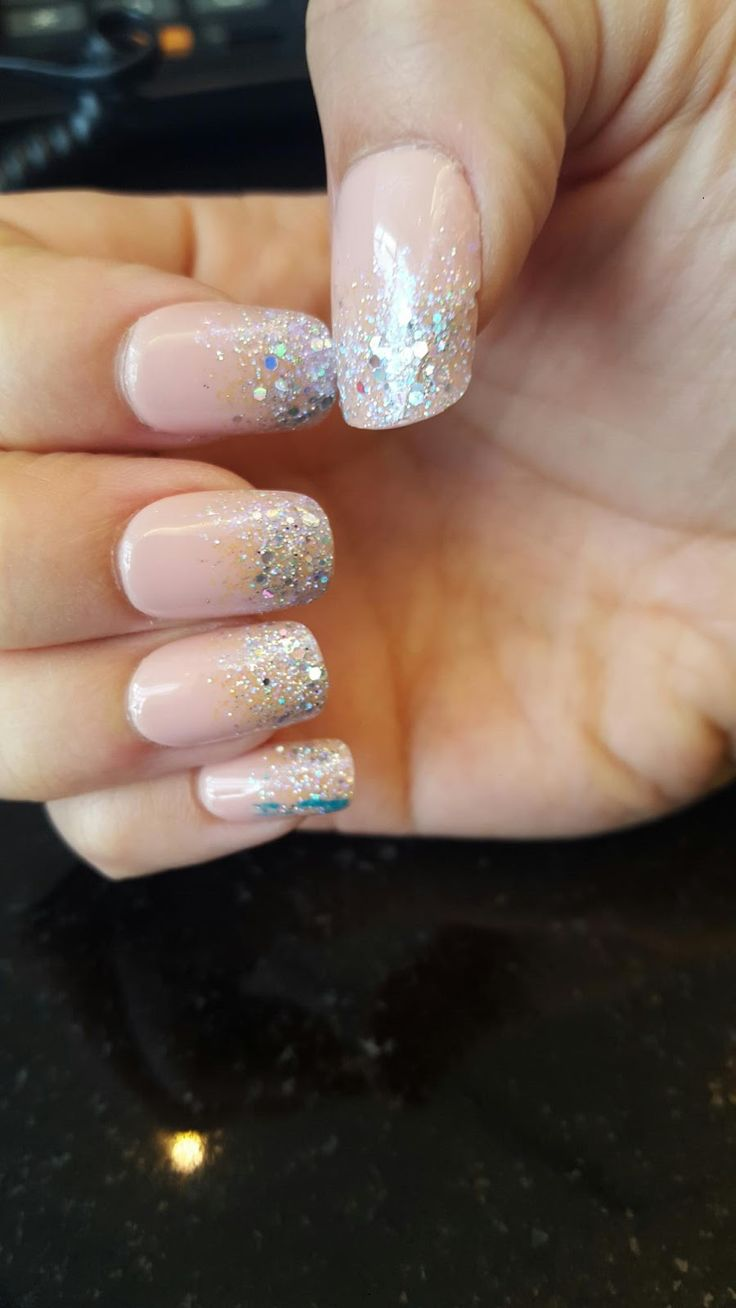 Drugstore press ons. Got about a 2 weeks out of these. Kiss gel nails. Pink glittery nails.