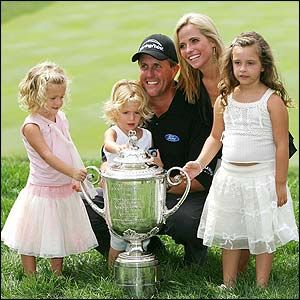 Phil Mickelson with his wife & daughters after a win.
