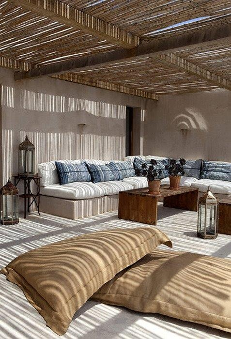 built in courtyard, hessian sack cushions and lanterns
