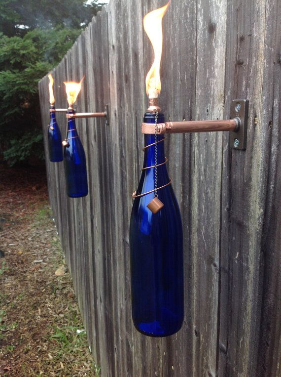 Cobalt Blue Wine Bottle Lanterns  by IlluminusCreations  Find this and other great items on their Etsy site, and at Loved Again Children's Boutique.