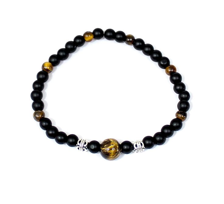 The Caspian Bracelet is named after one of the largest tiger species ever. This is made with a large tiger's eye bead, a couple silver plated barrel beads, a few smaller tiger's eye beads, and finished up with matte black beads. This is easily one of my classiest and most stylish designs yet, and it's a must have for anyone. #ribbonandsteel #bracelet #tigerseye #gemstone