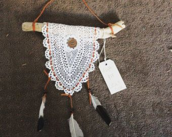 A drift- a timeless piece. Beautiful doily draped over a piece of driftwood, with Australian leather and whistling kite feathers. $25
