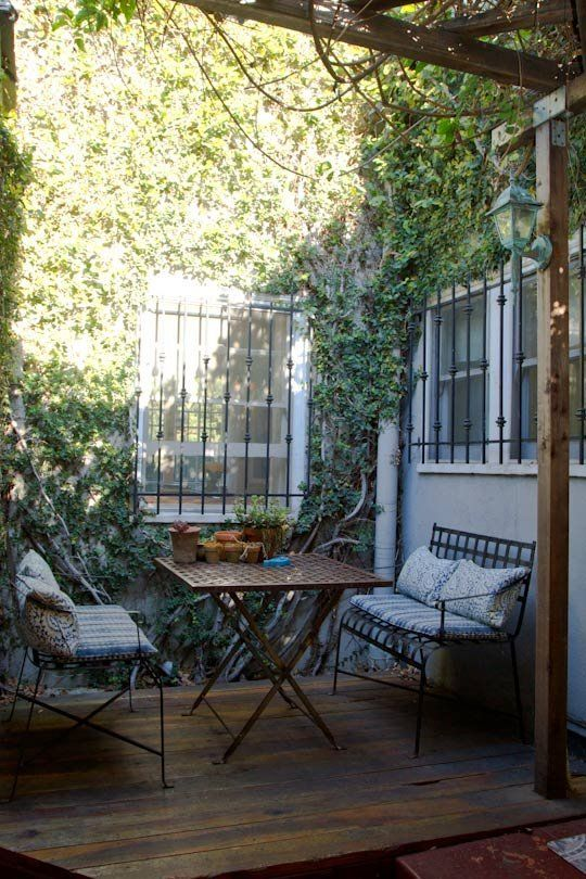 """Heavenly outdoor breakfast nook in this small house, with a style the owner calls """"Paris apartment meets beach house."""" 