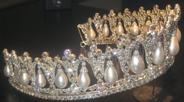 Pearl Poire Tiara  Creation:   Made in Berlin in 1825.  Queen Louise of Denmark left it to the Danish Royal Property Trust 1926 which means that is always belongs to the reigning monarch and cannot be sold or given away.    Materials:  18 pear shaped pearls and diamonds