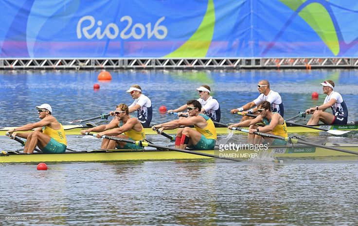 Silver for Australia's Joshua Booth, Australia's Joshua Dunkley-Smith, Australia's Alexander Hill and Australia's William Lockwood behind Britain's Alex Gregory, Britain's Constantine Louloudis, Britain's George Nash and Britain's Mohamed Sbihi during the Men's Four final rowing competition at the Lagoa stadium during the Rio 2016 Olympic Games in Rio de Janeiro on August 12, 2016. / AFP / Damien MEYER
