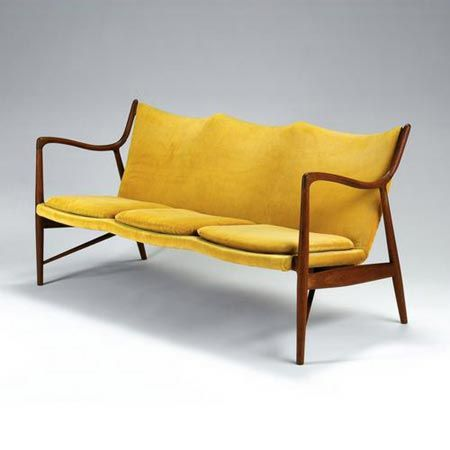 Finn Juhl, bien sur. Note the Indy-sculpted single back w/Indy sculpted multi seats.