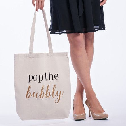 Whether it's for your bachelorette party or your wedding guests, everyone is sure to love an excuse to pop the bubbly. Fill this large, sturdy tote with mini ch
