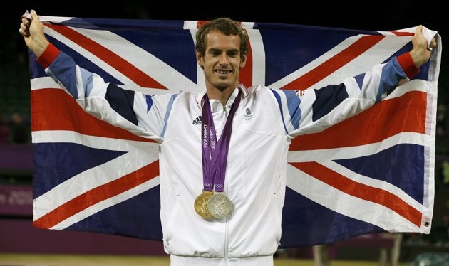 Murray of Britain poses with his two medals during the presentation ceremony for tennis mixed doubles at the All England Lawn Tennis Club during the London 2012 Olympic Games