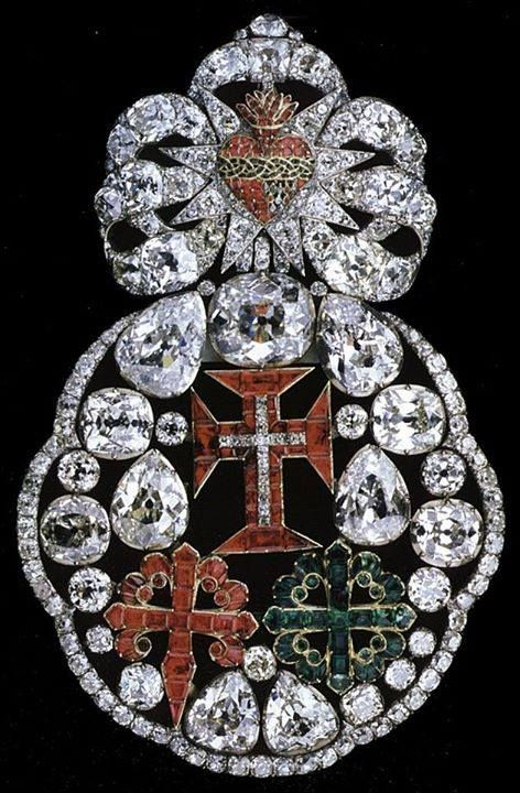 18th century jeweled badge featuring the Sacred Heart of Jesus above the three Christian Orders of Chivalry of the Portuguese monarchy top cross: Royal Order of the Knights of Our Lord Jesus Christ left cross: Order of Saint Benedict of Aviz, later renamed the Royal Military Order of Aviz right cross: Order of Saint James of the Sword This piece is part of the Portuguese Crown Jewels