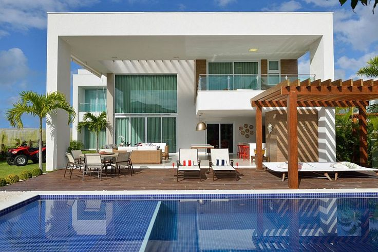 Color of the pool tiles gives the exterior a vivacious zest Beach House: Reinventing the Nautical Theme with Contemporary Panache