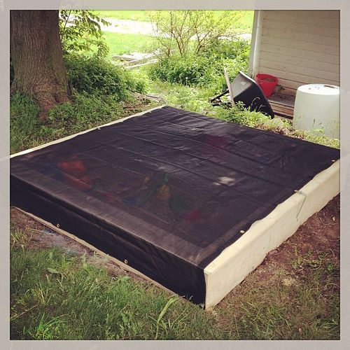 Here is the cover for the sandbox. It's a mesh tarp to let air and water move through, but not cats and leaves. | Flickr - Photo Sharing!