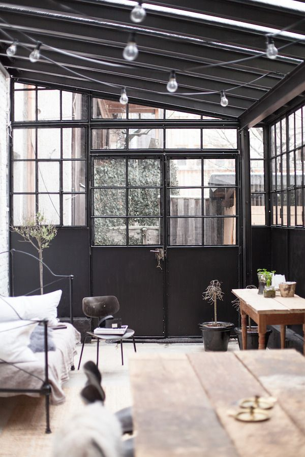 we love the dark walls and abundance of light in this conservatory! imagine what it would look like full of plants!!