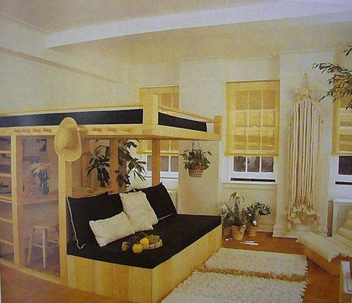 Here's another King-size loft bed.  Looks like they use this room as an everything room, for a studio apt. perhaps.  I see bed, desk (under bed), and sofa.  This could also be just the bedroom if you don't have room for an office elsewhere chez vous.