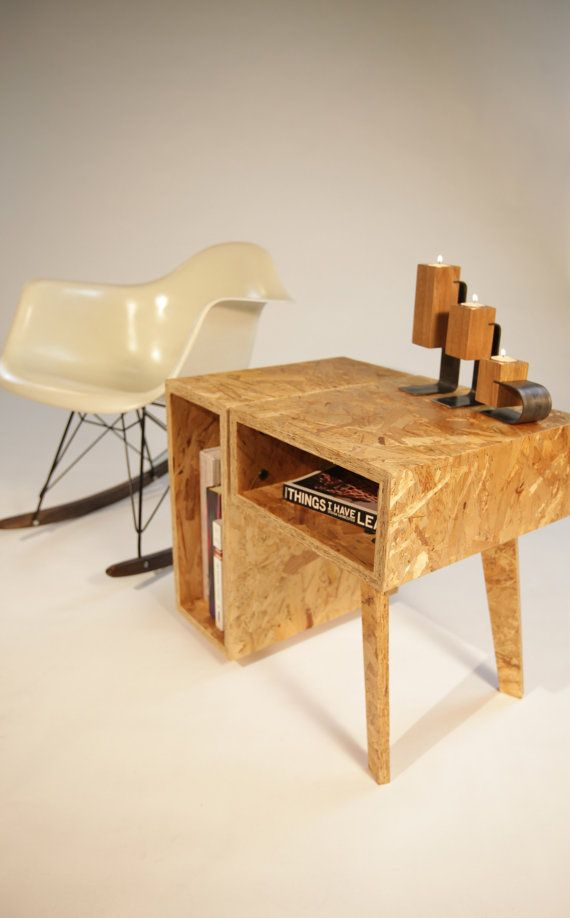 This rather clever piece of furniture was made from OSB, or, more properly, Oriented Strand Board, a very crude manufactured wood product used in construction for things such as floor underlayment. Kudos to the designer for using such an unexpected material.