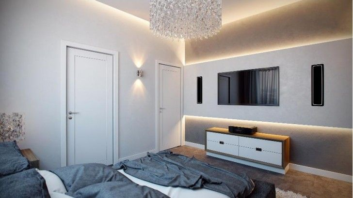 Bedroom With Tv And Lamp