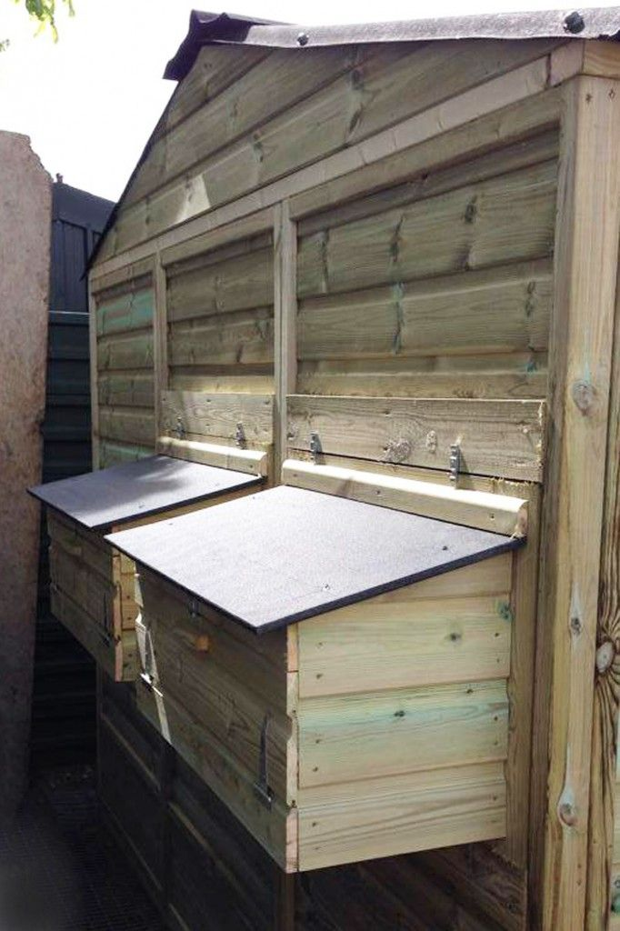 External nest boxes on a large walk in chicken coop and run built to replace storm damage chicken house