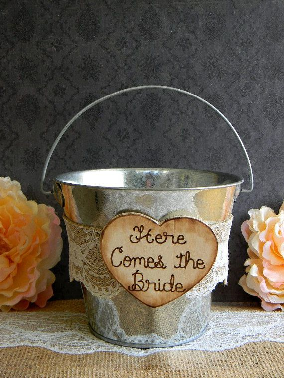 Flower Girl Tin Bucket. An easy DIY with lace and burlap trim and an added touch wood heart with 'Here Comes The Bride' sign attached. Cute for a country / rustic wedding theme.
