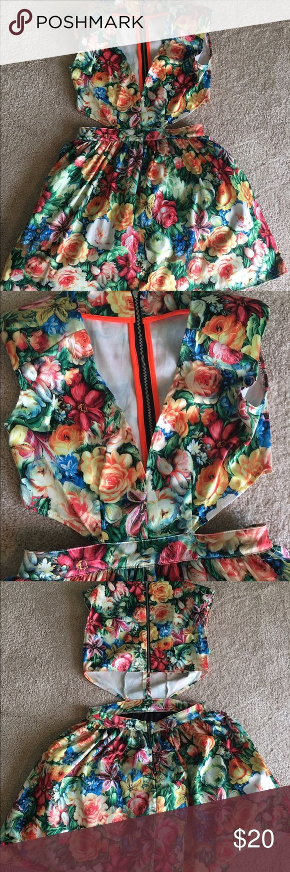 Flower Patterned Cut Out Dress Multi-colored flower patterned cut out dress. Excellent condition! Great for spring and summer AKIRA Dresses Mini