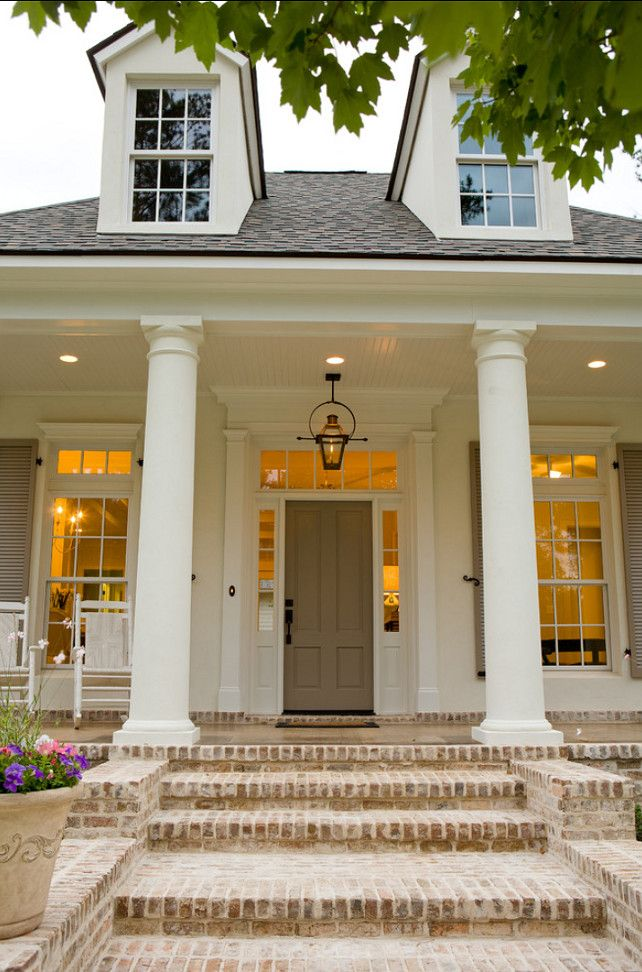 """{porch}Paint Color: Front Door and shutters are painted in """"Sherwin Williams Keystone Grey""""."""
