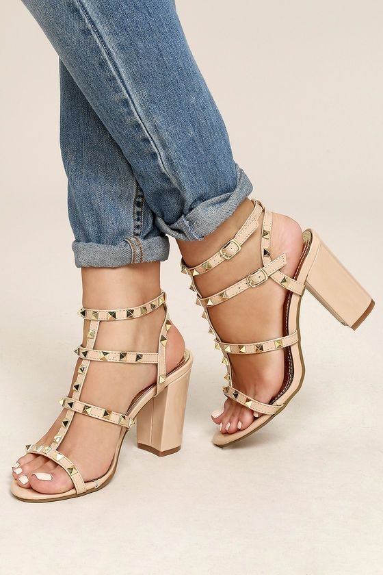 Hey starlet, we just know you need the Camila Nude Studded Ankle Strap Heels in your life! Patent vegan leather, decked out in trendy gold studs, shapes a peep toe upper, caged vamp, and adjustable quarter (and ankle strap), with shiny gold buckle.
